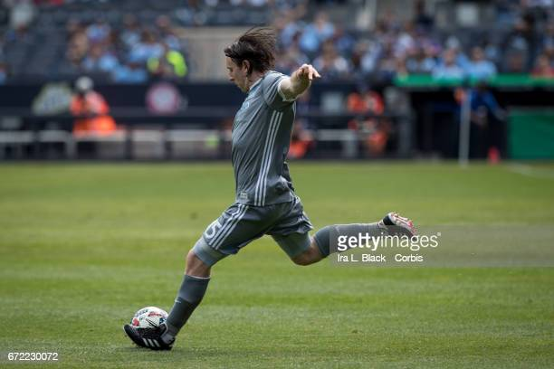 Thomas McNamara of New York City FC sends the ball across the pitch during the MLS match between New York City FC vs Orlando City SC on April 23 2017...