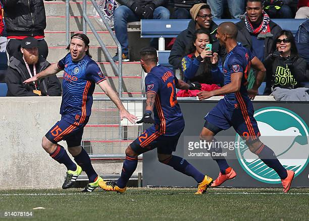 Thomas McNamara of the New York City FC celebrates a first half goal against the Chicago Fire with Ronald Matarrita and Tony Taylor at Toyota Park on...