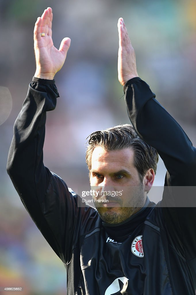 Thomas Meggle head coach of St Pauli returns to the duggout after being suspended during the Second Bundesliga match between FC St Pauli and 1 FC...
