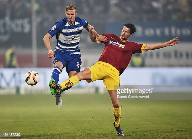 Thomas Meissner of MSV Duisburg and Nick Proschwitz of SC Paderborn battle for the ball during the Second Bundesliga match between MSV Duisburg and...