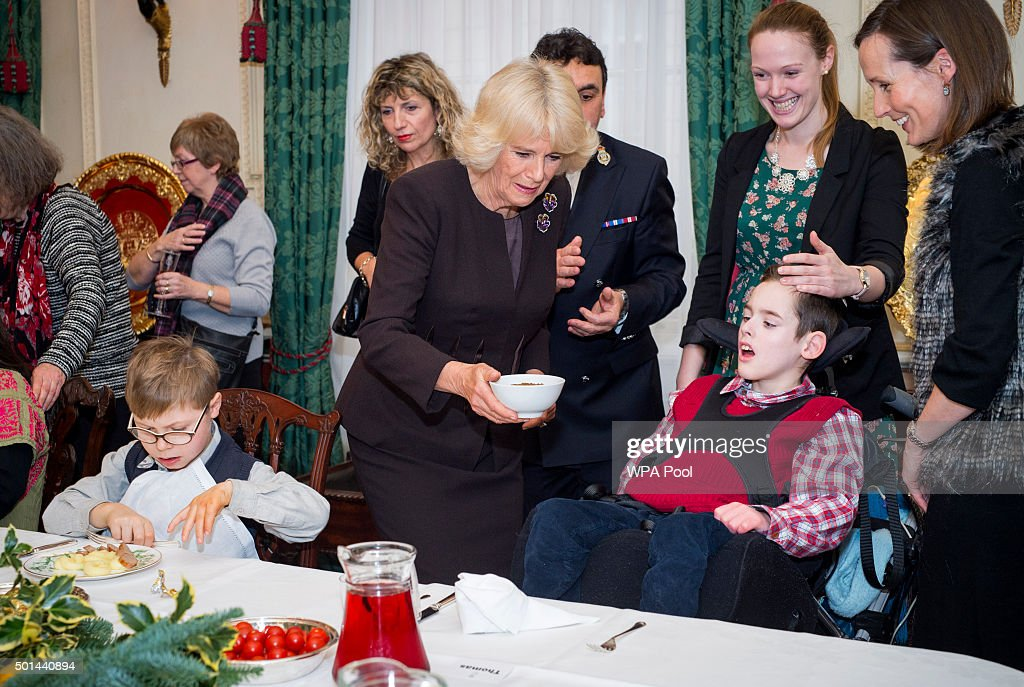 Thomas Melville-Ross 12 joins Camilla, Duchess of Cornwall, patron of the Helen & Douglas House and The London Taxidrivers' Fund as she invites underprivileged children from both charities to decorate the Christmas tree and join the Duchess for Christmas lunch at Clarence House on December 15, 2015 in London, England.