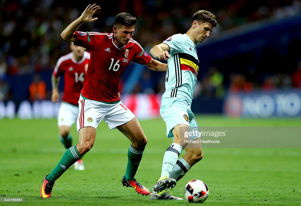 <a gi-track='captionPersonalityLinkClicked' href=/galleries/search?phrase=Thomas+Meunier&family=editorial&specificpeople=8330376 ng-click='$event.stopPropagation()'>Thomas Meunier</a> of Belgium and Adam Pinter of Hungary compete for the ball during the UEFA EURO 2016 round of 16 match between Hungary and Belgium at Stadium Municipal on June 26, 2016 in Toulouse, France.