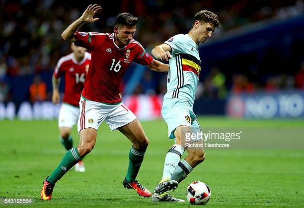 Thomas Meunier of Belgium and Adam Pinter of Hungary compete for the ball during the UEFA EURO 2016 round of 16 match between Hungary and Belgium at...