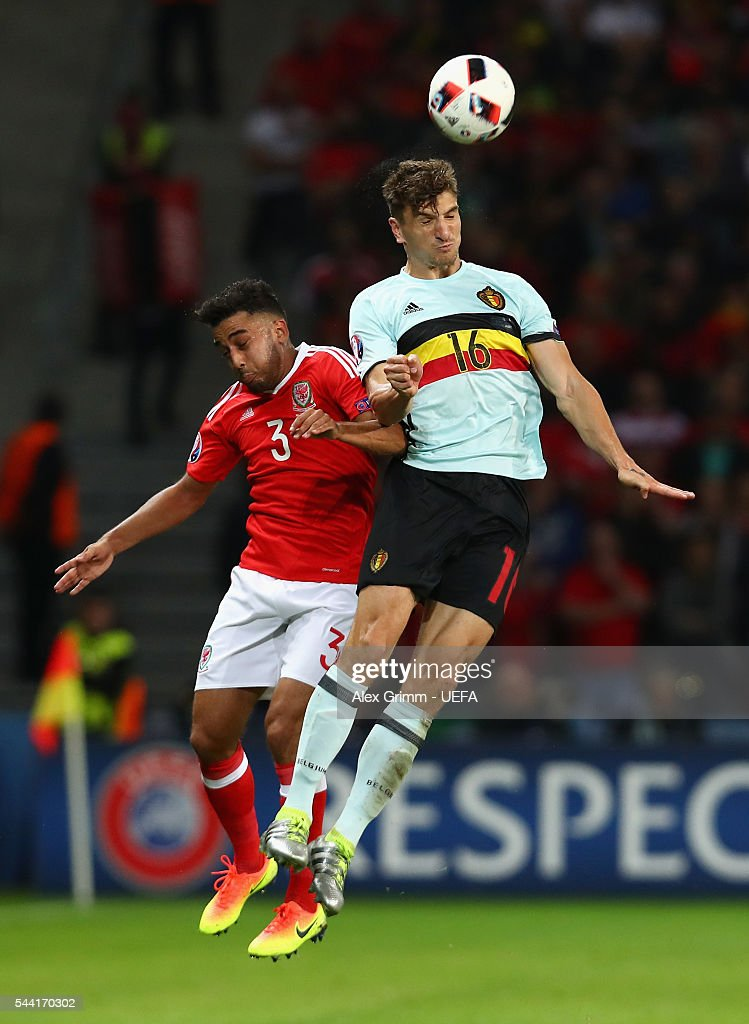 <a gi-track='captionPersonalityLinkClicked' href=/galleries/search?phrase=Thomas+Meunier&family=editorial&specificpeople=8330376 ng-click='$event.stopPropagation()'>Thomas Meunier</a> of Belgium and Neil Taylor of Wales jump for the ball during the UEFA EURO 2016 quarter final match between Wales and Belgium at Stade Pierre-Mauroy on July 1, 2016 in Lille, France.