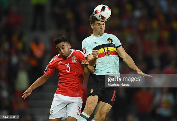 Thomas Meunier of Belgium and Neil Taylor of Wales jump for the ball during the UEFA EURO 2016 quarter final match between Wales and Belgium at Stade...