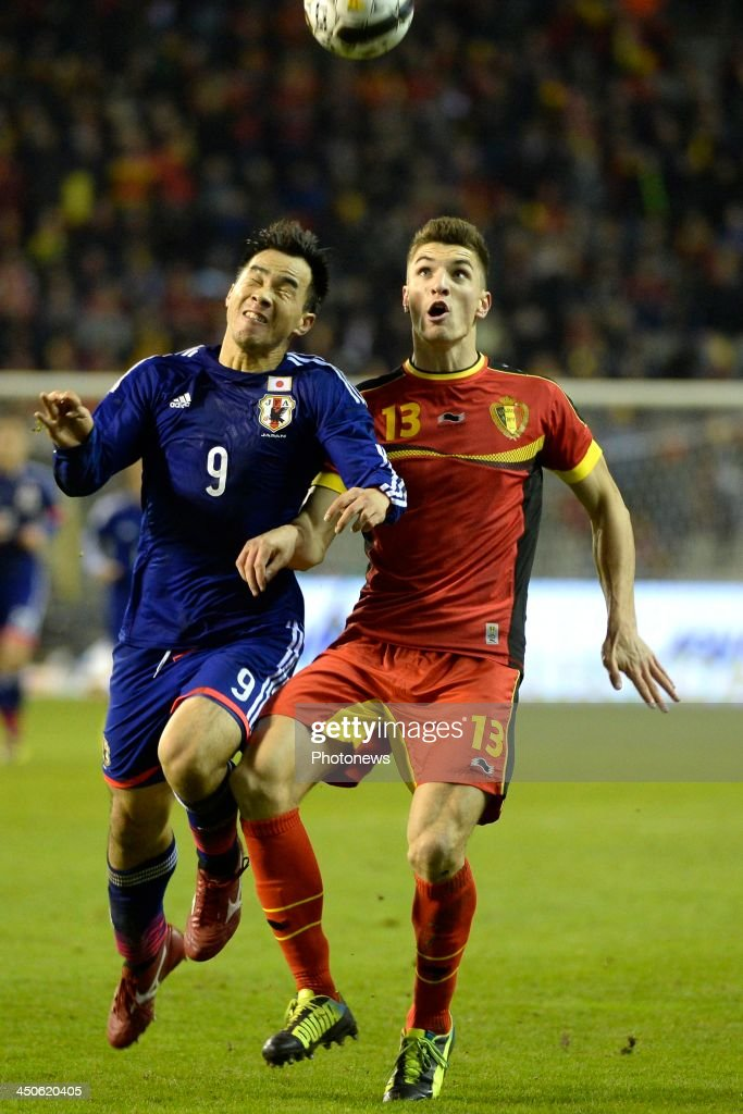 Thomas Meunier of Belgium and Okazaki Shinji of Japan pictured during the international friendly match before the World Cup in Brasil between Belgium and Japan on November 19, 2013 in Brussels, Belgium