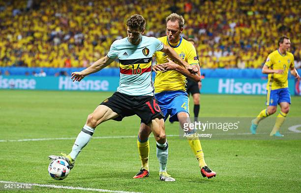 Thomas Meunier of Belgium holds off Andreas Granqvist of Sweden during the UEFA EURO 2016 Group E match between Sweden and Belgium at Allianz Riviera...