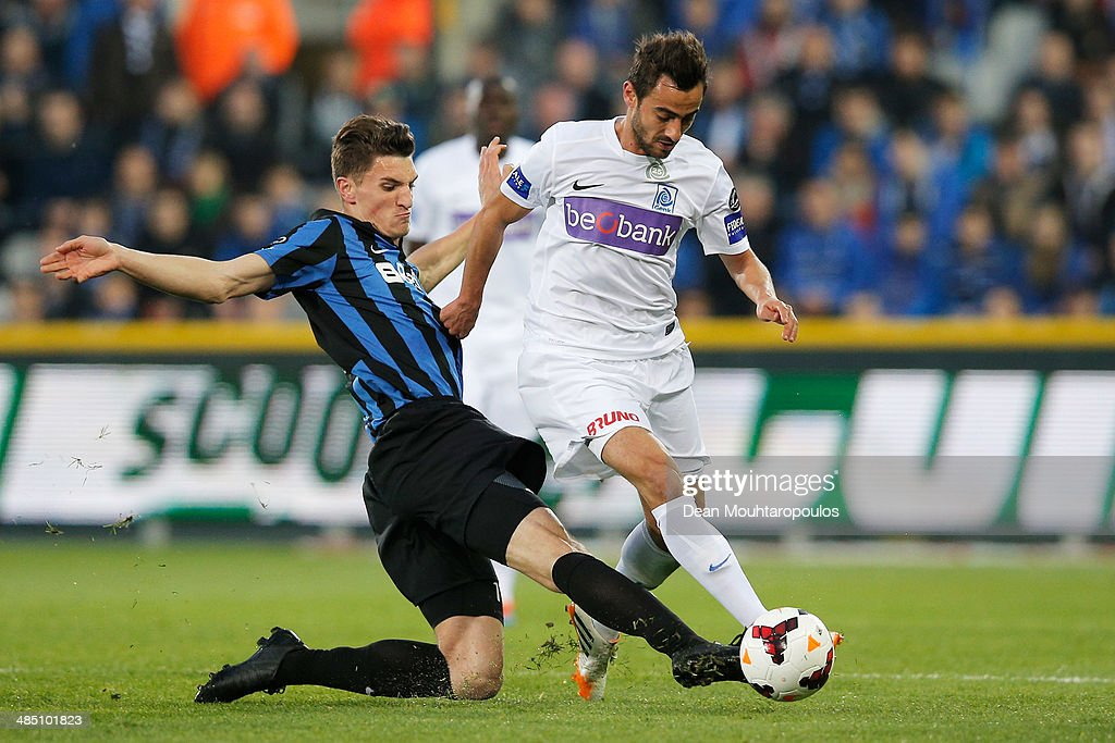 <a gi-track='captionPersonalityLinkClicked' href=/galleries/search?phrase=Thomas+Meunier&family=editorial&specificpeople=8330376 ng-click='$event.stopPropagation()'>Thomas Meunier</a> of Club Brugge and <a gi-track='captionPersonalityLinkClicked' href=/galleries/search?phrase=Fabien+Camus&family=editorial&specificpeople=5702744 ng-click='$event.stopPropagation()'>Fabien Camus</a> of Racing Genk battle for the ball during the Jupiler League match between Club Brugge v Racing Genk at the Jan Breydel Stadium on April 16, 2014 in Brugge, Belgium.