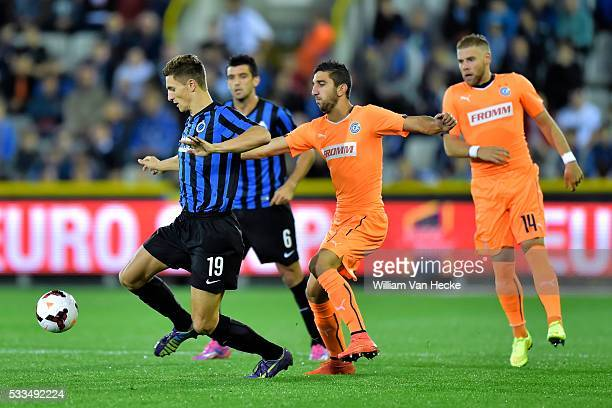 Thomas Meunier of Club Brugge in front of Munas Dabbur of Grasshopper Club during the UEFA Europa League PlayOffs second leg match between Club...