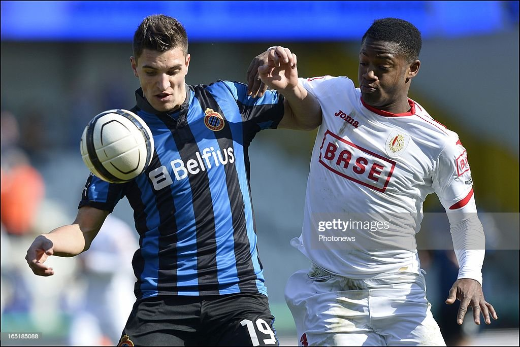 Thomas Meunier of Club Brugge KV is challenged by Michy Batshuayi of Standard during the Jupiler League match between Club Brugge and Standard de Liege on April 01, 2013 in the Jan Breydel Stadium in Brugge, Belgium.