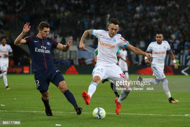 Thomas Meunier of Paris SaintGermain and Lucas Ocampos of Marseille during the Ligue 1 match between Olympique Marseille and Paris Saint Germain at...