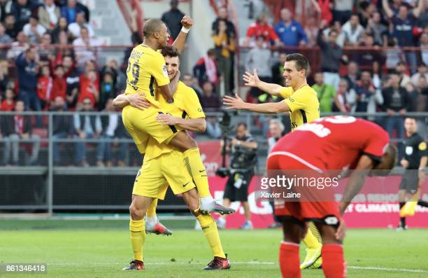 Thomas Meunier of Paris SaintGermain celebrate his goal with Kylian Mbappe and Giovani Lo Celso during the Ligue 1 match between Dijon FCO and Paris...