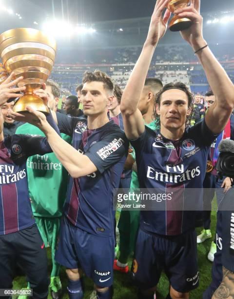 Thomas Meunier of Paris SaintGermain hold the trophy with Edinson Cavani after the French League Cup Final match between Paris SaintGermain and AS...