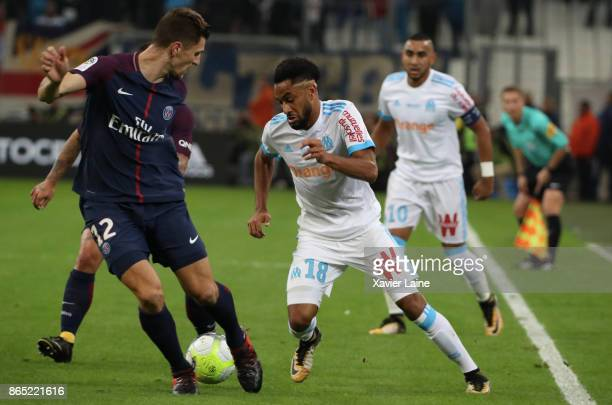 Thomas Meunier of Paris SaintGermain in action with Jordan Amavi of Olympique Marseille during the Ligue 1 match between Olympique Marseille and...