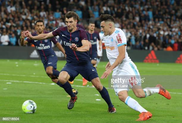 Thomas Meunier of Paris SaintGermain in action with Lucas Ocampos of Olympique Marseille during the Ligue 1cmatch between Olympique Marseille and...