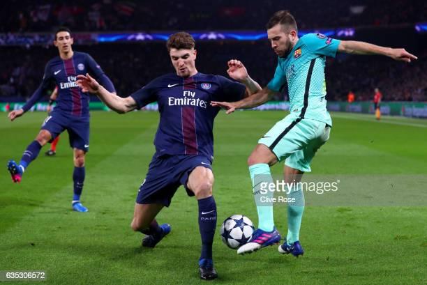 Thomas Meunier of Paris SaintGermain tackles Jordi Alba of Barcelona during the UEFA Champions League Round of 16 first leg match between Paris...