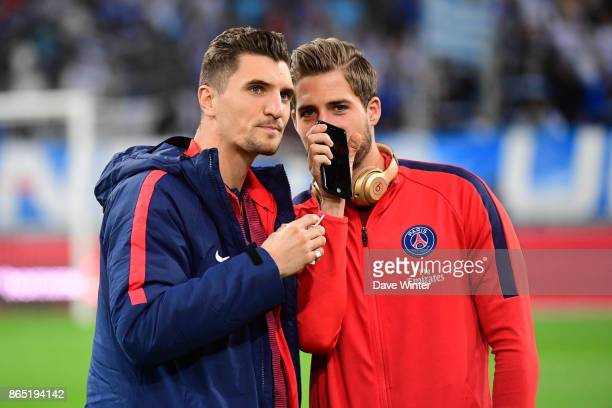 Thomas Meunier of PSG and Kevin Trapp of PSG share a confidence before the Ligue 1 match between Olympique Marseille and Paris Saint Germain at Stade...
