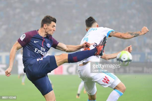 Thomas Meunier of PSG and Lucas Ocampos of Marseille during the Ligue 1 match between Olympique Marseille and Paris Saint Germain at Stade Velodrome...