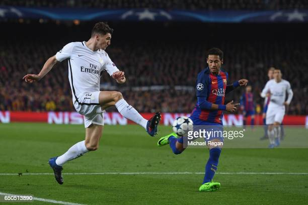 Thomas Meunier of PSG battles Neymar of Barcelona during the UEFA Champions League Round of 16 second leg match between FC Barcelona and Paris...