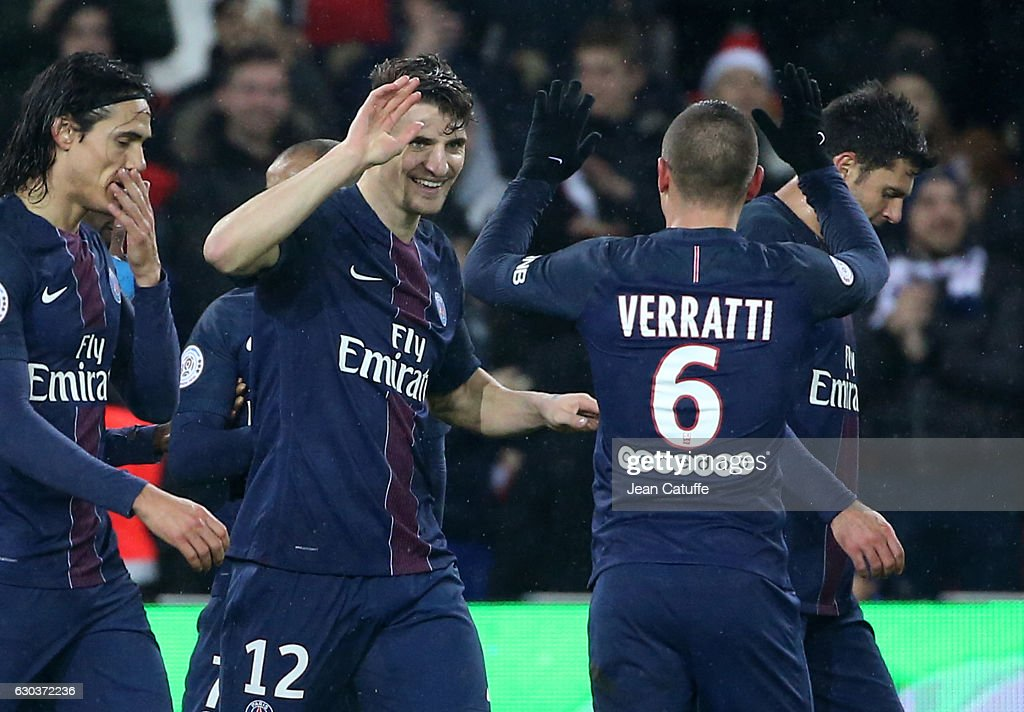 Thomas Meunier of PSG celebrates his goal with Marco Verratti during the French Ligue 1 match between Paris Saint-Germain (PSG) and FC Lorient at Parc des Princes stadium on December 21, 2016 in Paris, France.