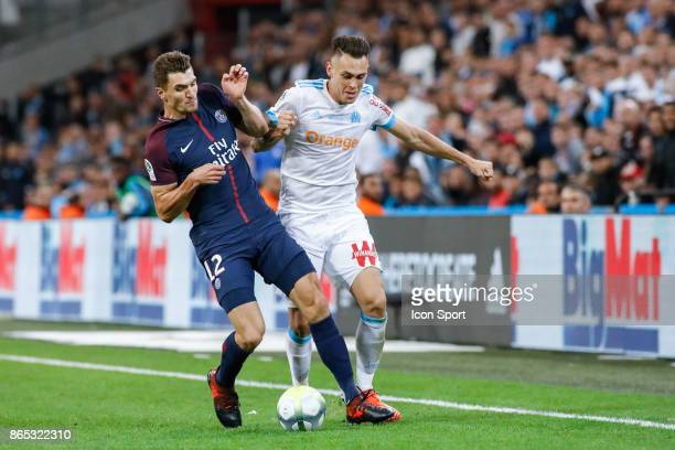 Thomas Meunier of PSG Lucas Ocampos of Marseille and Thomas Meunier of Paris during the Ligue 1 match between Olympique Marseille and Paris Saint...
