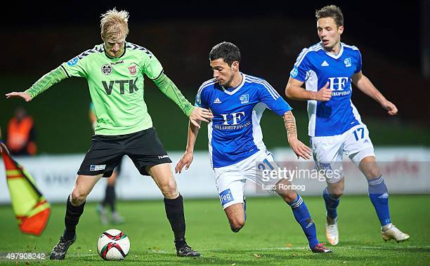 Thomas Mikkelsen of Vejle Boldklub and David Katz Boysen of Lyngby Boldklub compete for the ball during the Danish 1th Division Bet25 Liga match...