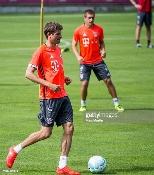 Thomas Mller and Philipp Lahm of FC Bayern Munich are seen during an training session on August 17 2016 in Munich Germany