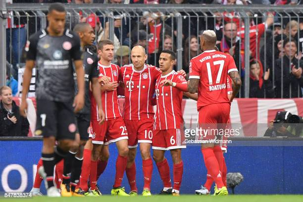 Thomas Müller celebrates after he scored the first goal to make it 10 with Arjen Robben Thiago Alcantara and Jerome Boateng of Bayern Muenchen during...