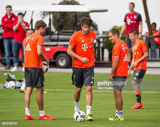 Thomas Müller Javi Martínez and Philipp Lahm of FC Bayern Munich are seen during an training session on August 17 2016 in Munich Germany