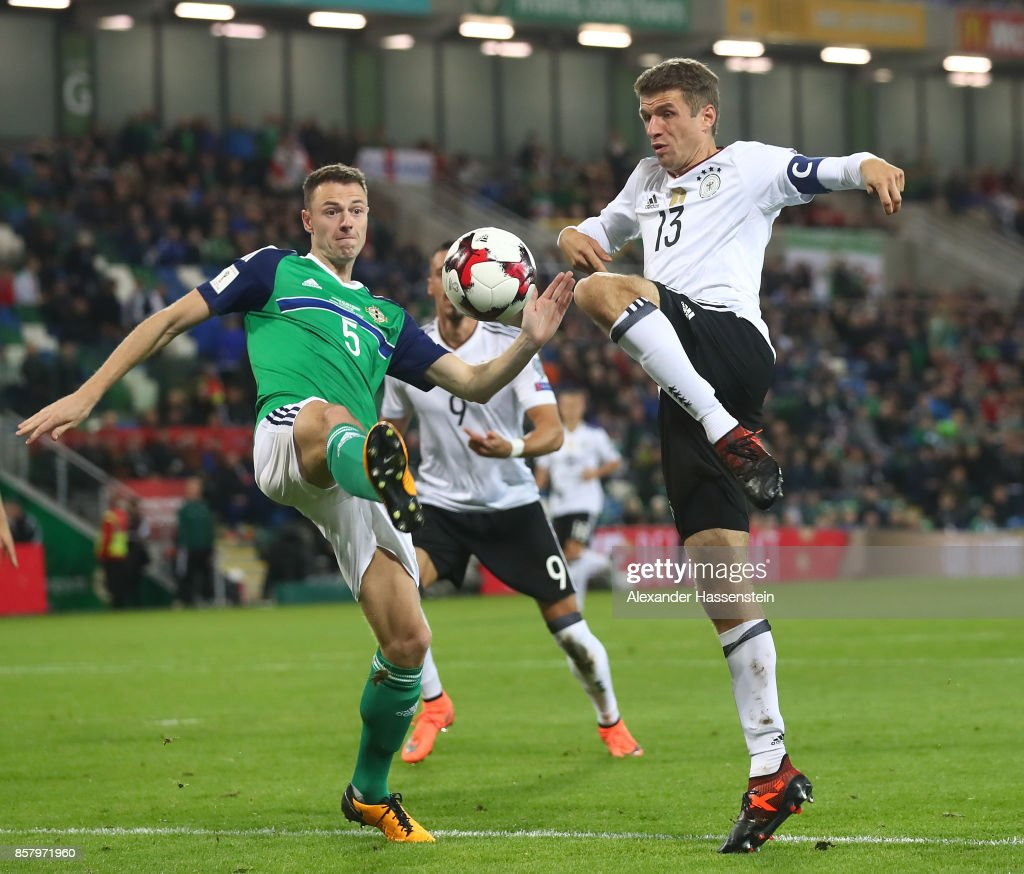 Thomas Mller of Germany is challenged by Jonny Evans of Northern Ireland during the FIFA 2018 World Cup Qualifier between Northern Ireland and Germany at Windsor Park on October 5, 2017 in Belfast, Northern Ireland.