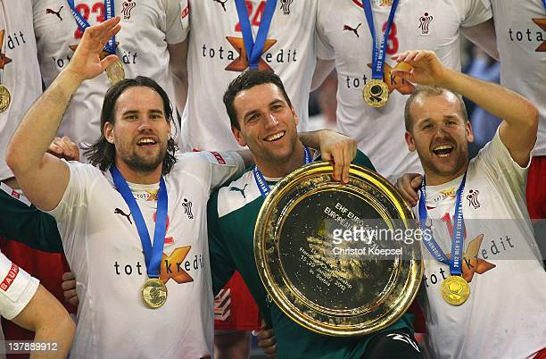 Thomas Mogensen Marcus Cleverly and Anders Eggert Jensen of Denmark pose with the EHF tropy on the podium after winninbg 2119 the Men's European...