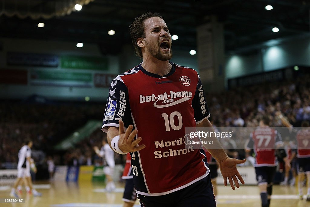 <a gi-track='captionPersonalityLinkClicked' href=/galleries/search?phrase=Thomas+Mogensen&family=editorial&specificpeople=4060426 ng-click='$event.stopPropagation()'>Thomas Mogensen</a> of Flensburg celebrates during the DKB Handball Bundesliga match between Flensburg-Handewitt and THW Kiel at Campus Hall on December 26, 2012 in Flensburg, Germany.