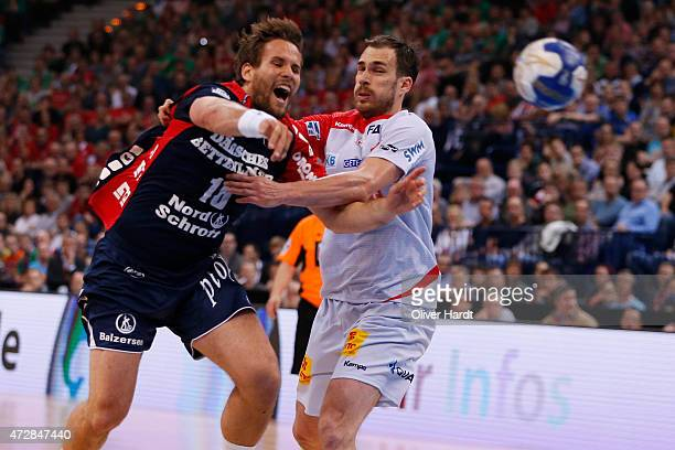 Thomas Mogensen of Flensburg challenges for the ball with Jure Natek of Magdeburg during the DHB Cup Final match between SG FlensburgHandewitt and SC...