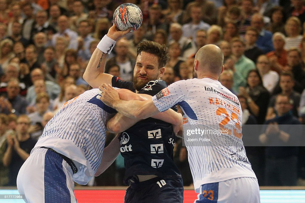 Thomas Mogensen of Flensburg is challenged by Vid Kavticnik of Montpellier during the Velux EHF Champions League round of 16 second leg match between...