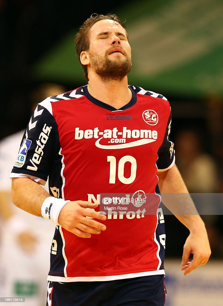 <a gi-track='captionPersonalityLinkClicked' href=/galleries/search?phrase=Thomas+Mogensen&family=editorial&specificpeople=4060426 ng-click='$event.stopPropagation()'>Thomas Mogensen</a> of Flensburg reacts during the DKB Handball Bundesliga match between SG Flensburg-Handewitt and HSV Hamburg at Flens Arena on April 9, 2013 in Flensburg, Germany.