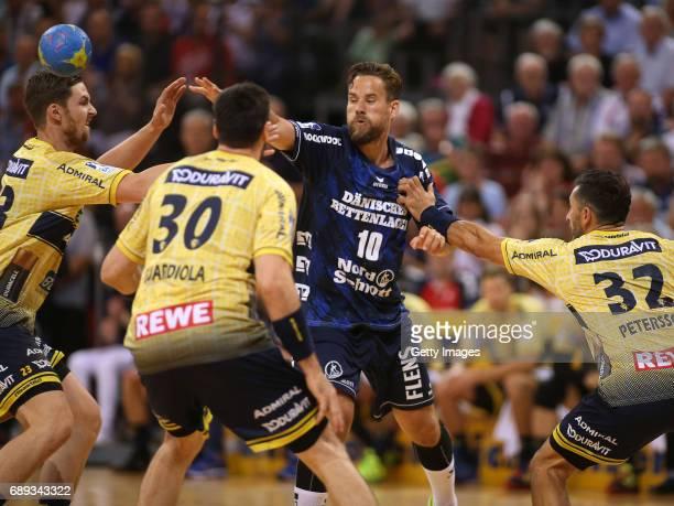 Thomas Mogensen of SG Flensburg Handewitt fights for the ball with Gedeon Guardiola of RheinNeckarLoewen at FlensArena on May 28 2017 in Flensburg...