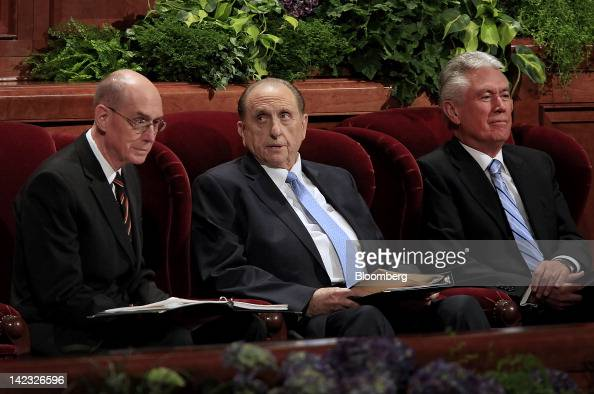 Thomas Monson president of the Church of Jesus Christ of Latterday Saints center speaks with first counselor Henry Eyring left while second counselor...