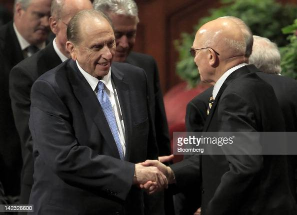 Thomas Monson president of the Church of Jesus Christ of Latterday Saints left shakes hands with Mormon Apostle Dallin Oaks during the 182nd Annual...
