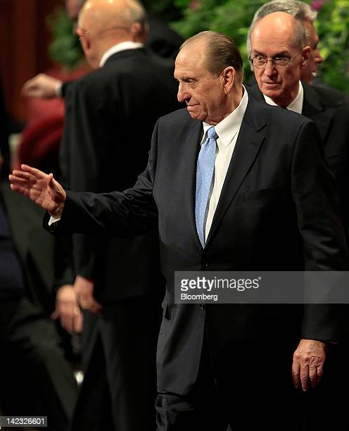 Thomas Monson president of the Church of Jesus Christ of Latterday Saints left waves to attendees while exiting with first counselor Henry Eyring...