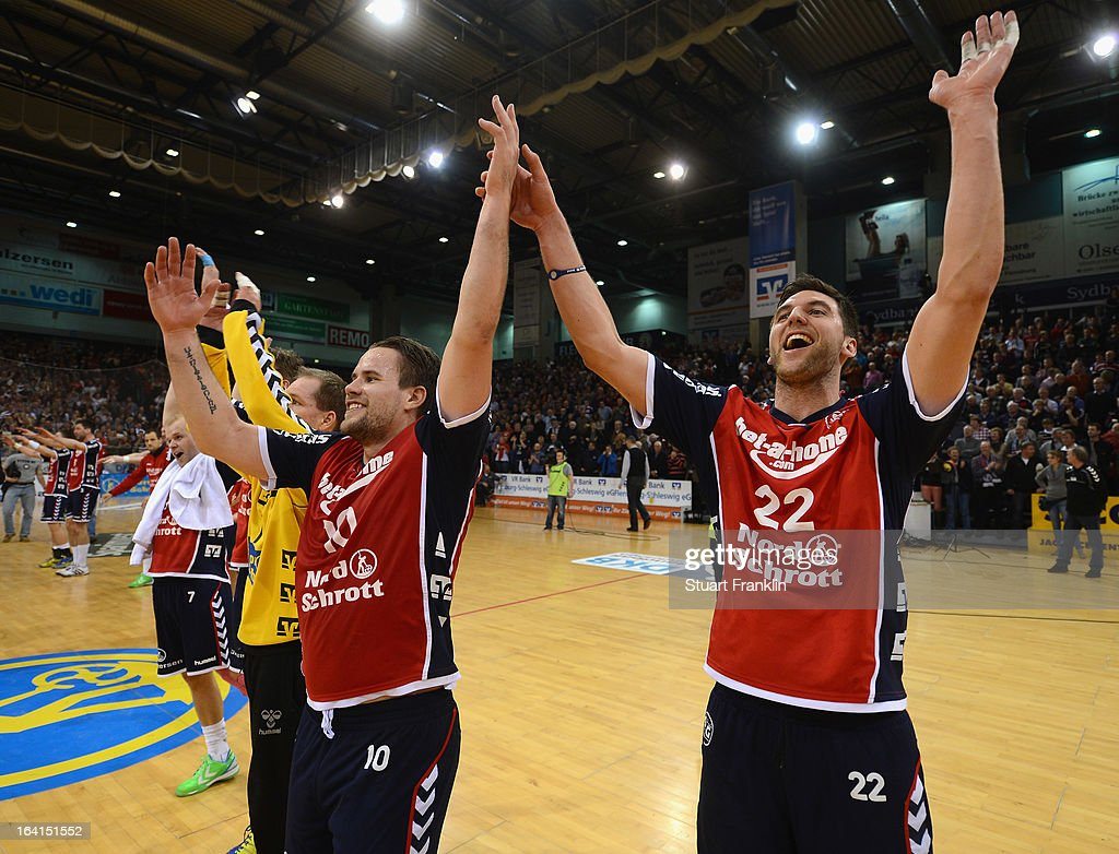 Thomas Morgensen and Olafur Gustafsson of Flensburg celebrate at the end of the Toyota Bundesliga handball game between SG Flensburg-Handewitt and Rhein-Neckar Loewen at the Flens arena on March 20, 2013 in Flensburg, Germany.