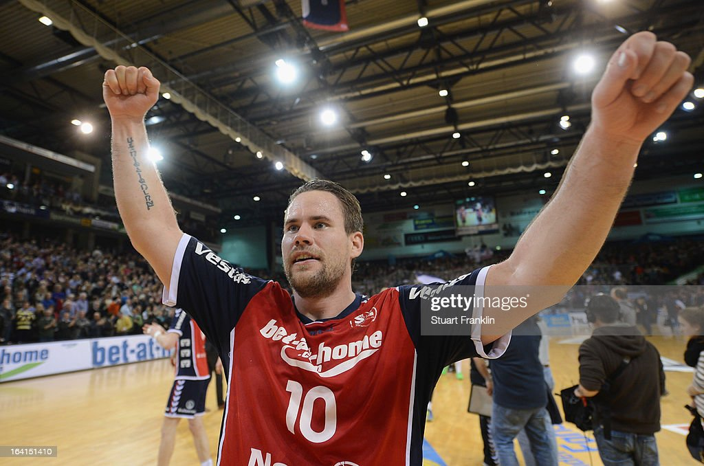 Thomas Morgensen of Flensburg celebrates at the end of the Toyota Bundesliga handball game between SG Flensburg-Handewitt and Rhein-Neckar Loewen at the Flens arena on March 20, 2013 in Flensburg, Germany.