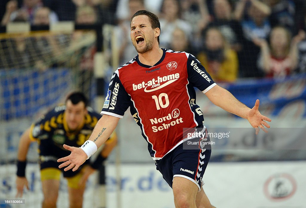 Thomas Morgensen of Flensburg celebrates during the Toyota Bundesliga handball game between SG Flensburg-Handewitt and Rhein-Neckar Loewen at the Flens arena on March 20, 2013 in Flensburg, Germany.
