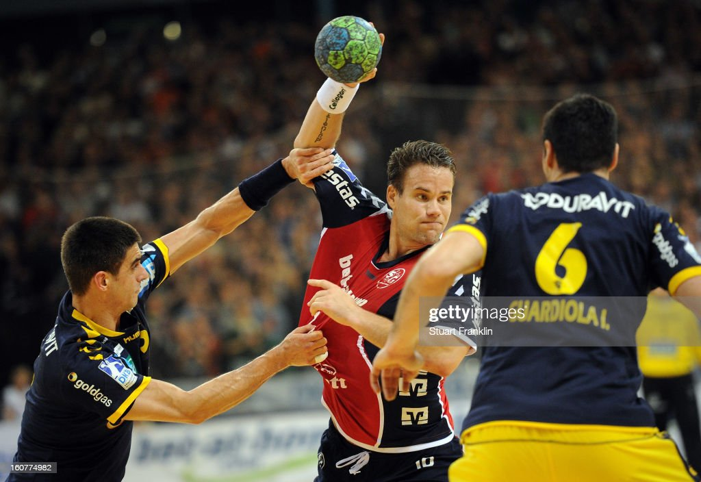 Thomas Morgensen of Flensburg challenges for the ball with Andy Schmid of Rhein-Neckar during the DHB cup game between SG Flensburg Handewitt and Rhein-Neckar Loewen at the Flens Arena on February 5, 2013 in Flensburg, Germany.