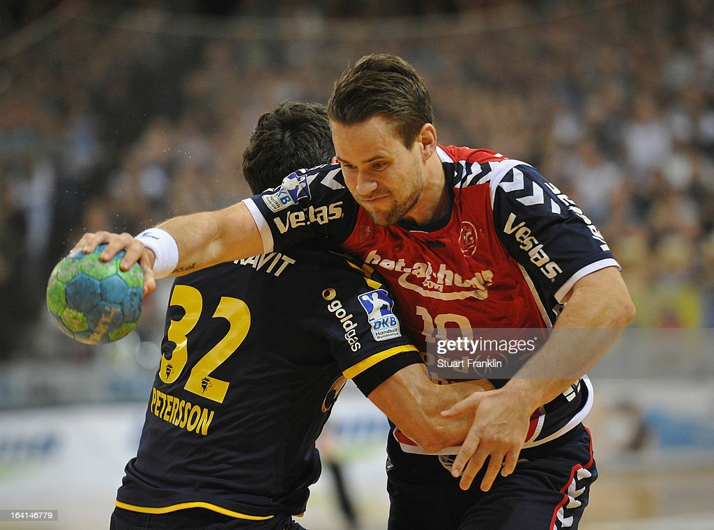 Thomas Morgensen of Flensburg is challenged by Alexander Petersson of Rhein-Neckar during the Toyota Bundesliga handball game between SG Flensburg-Handewitt and Rhein-Neckar Loewen at the Flens arena on March 20, 2013 in Flensburg, Germany.