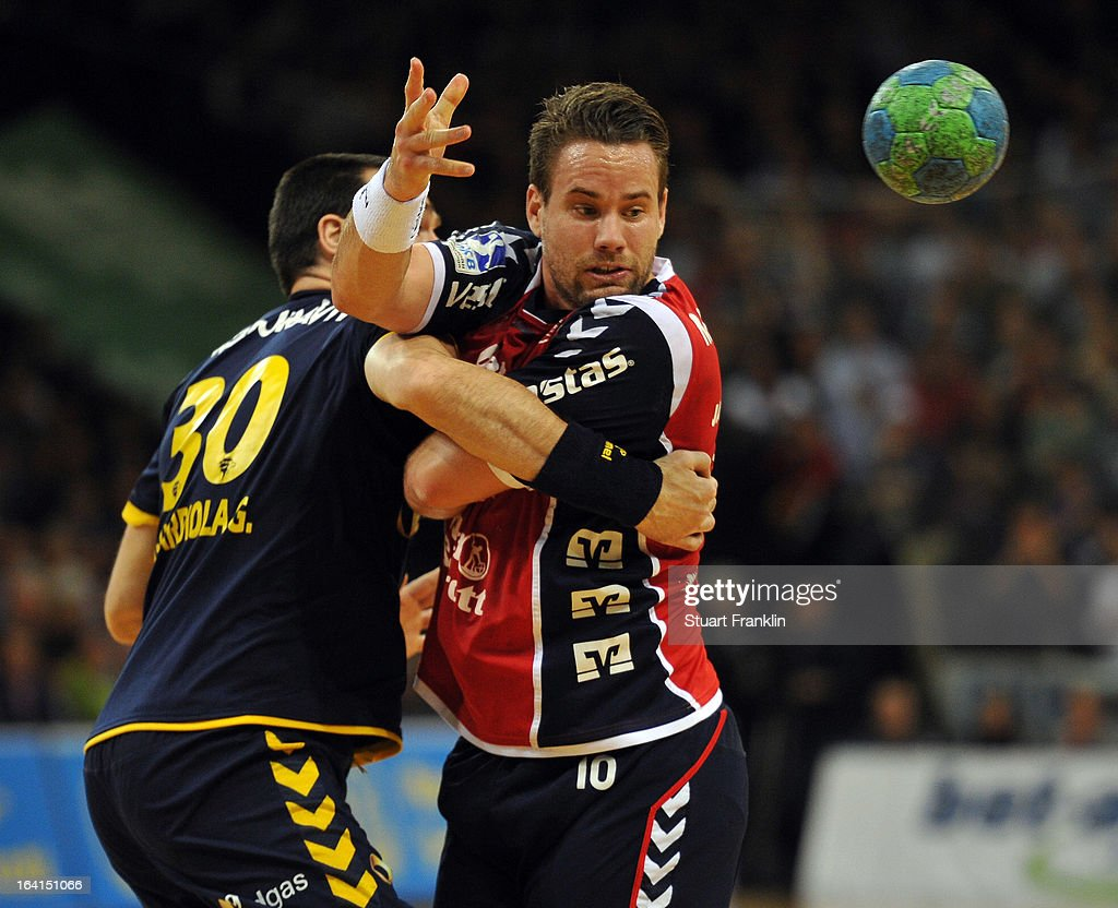 Thomas Morgensen of Flensburg is challenged by Gedeon Guardiola of Rhein-Neckar during the Toyota Bundesliga handball game between SG Flensburg-Handewitt and Rhein-Neckar Loewen at the Flens arena on March 20, 2013 in Flensburg, Germany.