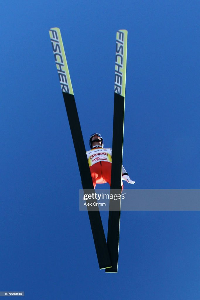 <a gi-track='captionPersonalityLinkClicked' href=/galleries/search?phrase=Thomas+Morgenstern&family=editorial&specificpeople=221616 ng-click='$event.stopPropagation()'>Thomas Morgenstern</a> of Austria competes during the trial round for the FIS Ski Jumping World Cup event at the 59th Four Hills ski jumping tournament at Olympiaschanze on January 1, 2011 in Garmisch-Partenkirchen, Germany.