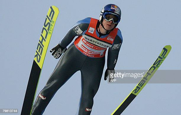 Thomas Morgenstern of Austria jumps to place fifth during the individual event of the Ski Jumping FIS World Cup in the western German town of...