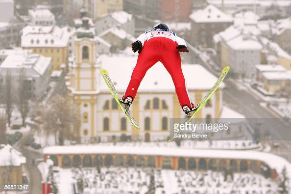 Thomas Morgenstern of Austria soars through the air above the Wilten basilica during the trial round the FIS Ski Jumping World Cup event at the 54th...
