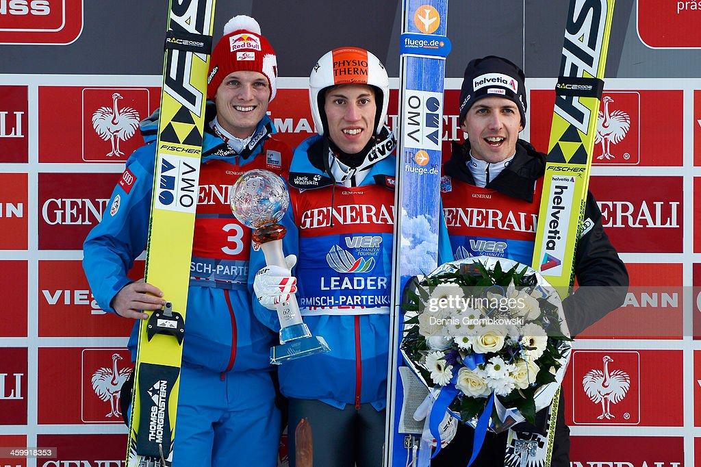 Thomas Morgenstern of Austria Thomas Diethart of Austria and Simon Ammann of Switzerland pose at the podium after the Four Hills Tournament event at...