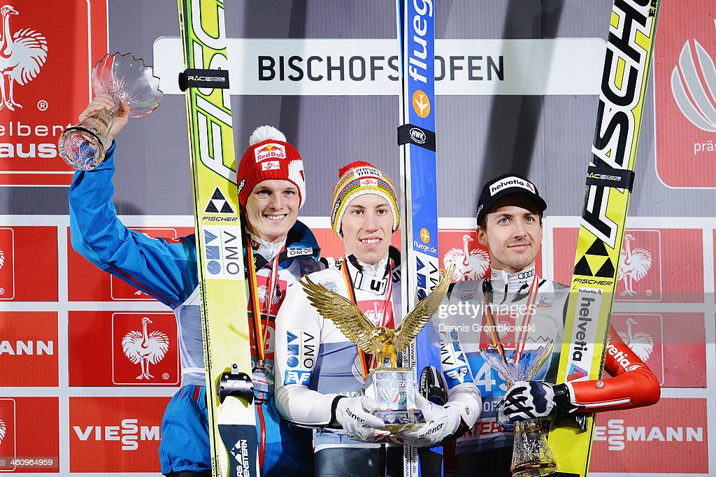 Thomas Morgenstern of Austria Thomas Diethart of Austria and Simon Ammann of Switzerland pose at the podium after the 62nd Four Hills Tournament at...